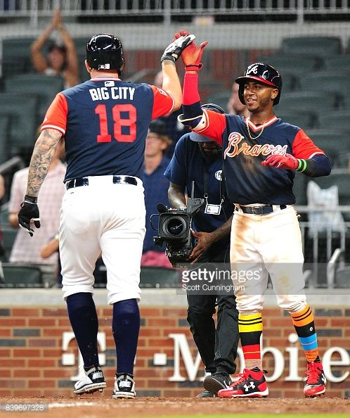 Matt Adams of the Atlanta Braves is congratulated by Ozzie Albies after hitting a ninth inning two-run home run against the Colorado Rockies at SunTrust Park on August 26, 2017 in Atlanta, Georgia.