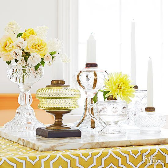 Build a translucent table centerpiece by clustering an assortment of crystal and glass oil lamps on a tray. No need to mess with kerosene to light up a room: The lamp openings once designed for wicks are ideally suited for holding a variety of candle sizes, and the decorative wells are great when used as vases./