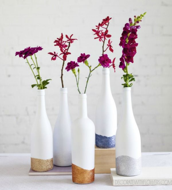 painted bottles as vases with sparkles