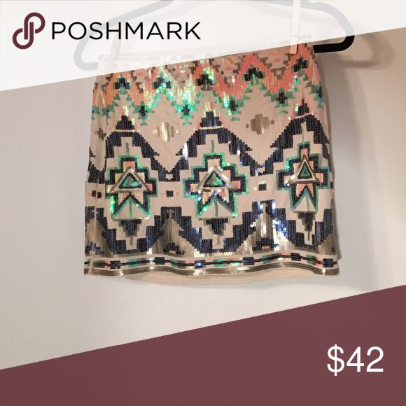 NWT Express mini skirt Aztec print sequins XS NWT Aztec print sequined mini 🤑 Price firm but will do BOGO 1/2 off on cheaper item if you buy 2 items 😘 Express Skirts Mini