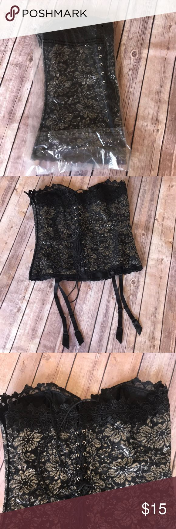 {Frederick's} Black & Silver Corset Bra Size 38 NWOT. This was only ever removed from the bag for pictures.  •Black and Metallic Silver Strapless corset •Lace-Up Back •Detatchable Hoisery Straps •Size 38 Frederick's of Hollywood Intimates & Sleepwear Bras