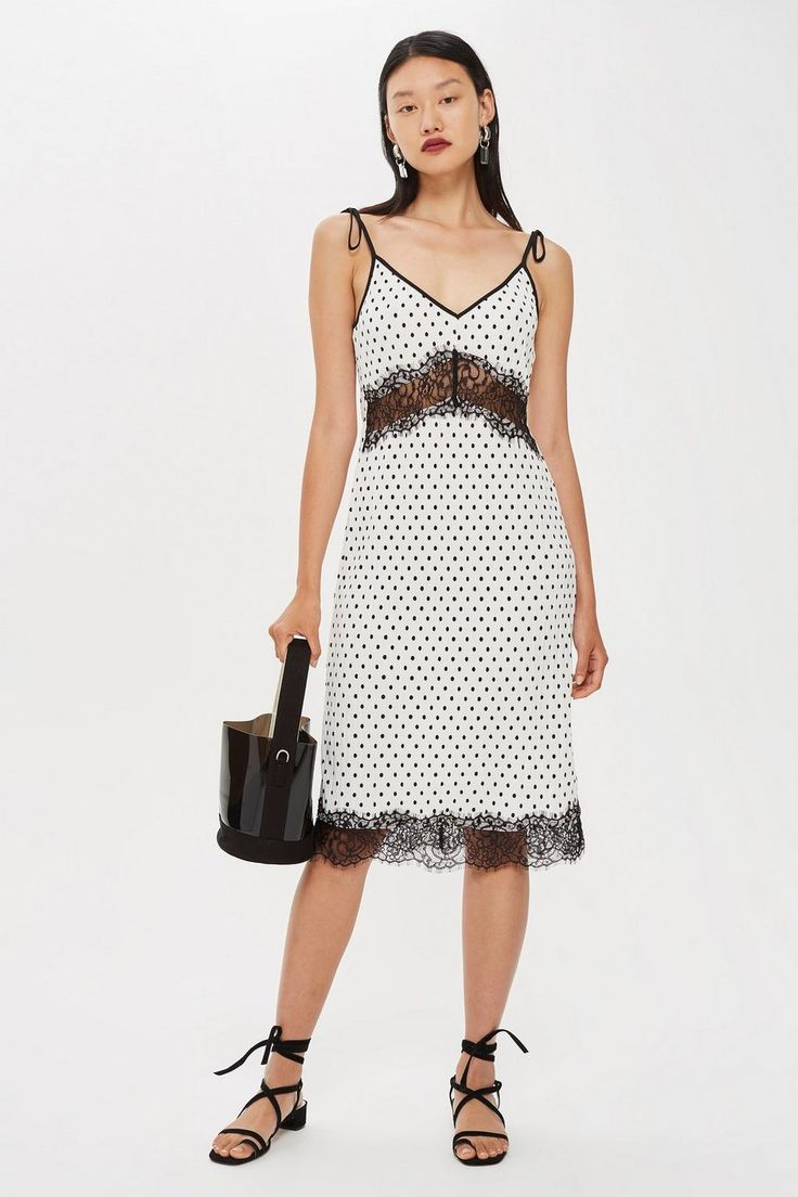 If you love the ultra -feminine slinky look then you are going to love this Spot plisse slip dress from Topshop. Looks great paired with sandals.
