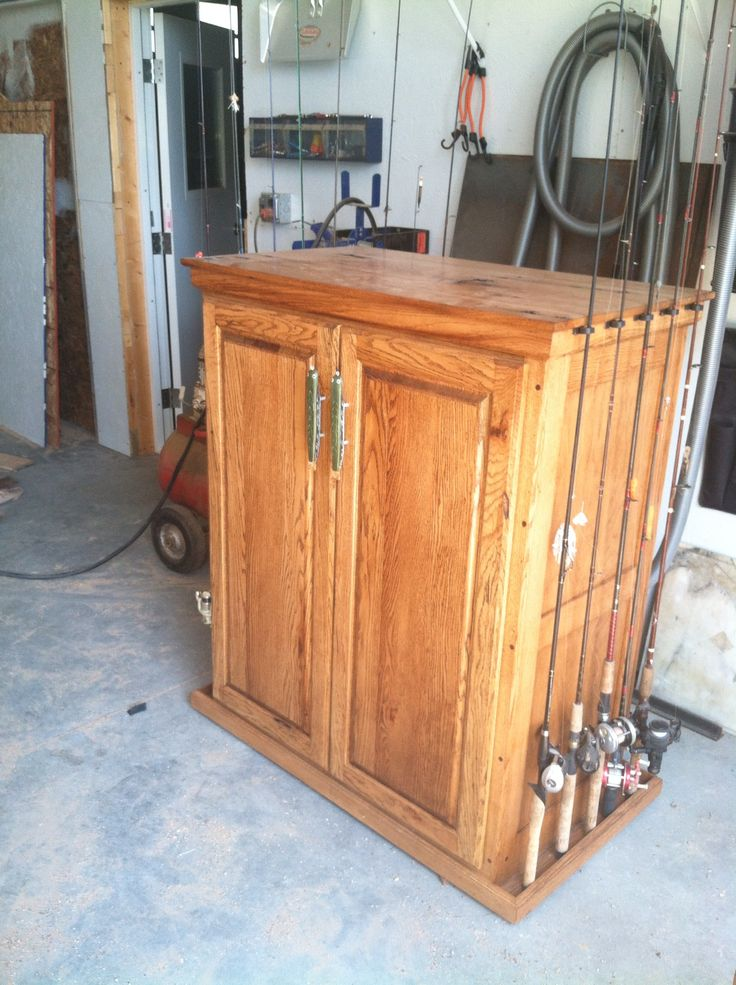 Fishing rod storage and cabinet woodworking pinterest for Homemade fishing rod storage ideas