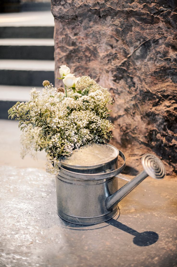 Watering Can Filled with Gypsophila Flower Arrangement Decor | Scottish Wedding | Autumn Wedding | Rustic Wedding | Barn Wedding | Grey & Yellow Colour Scheme | Image by Crofts & Kowalczyk Photography | http://www.rockmywedding.co.uk/jen-bob/