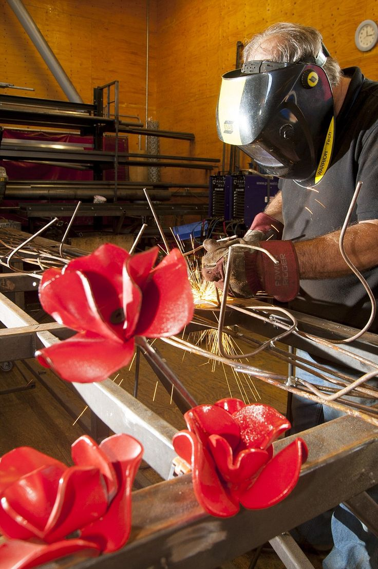 Work of wonder: Every poppy head was hand made, baked and glazed before the 2ft long stems were welded to them