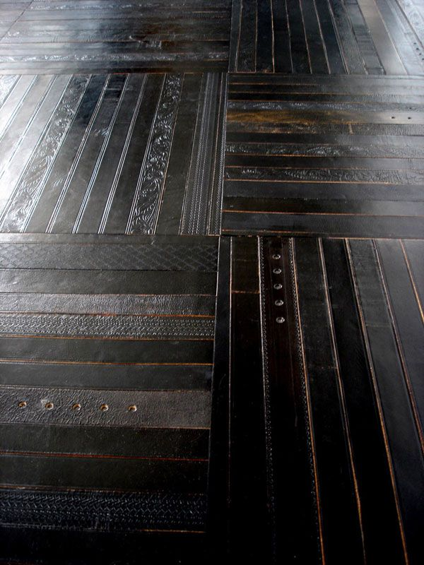 Flooring made from reclaimed leather belts.