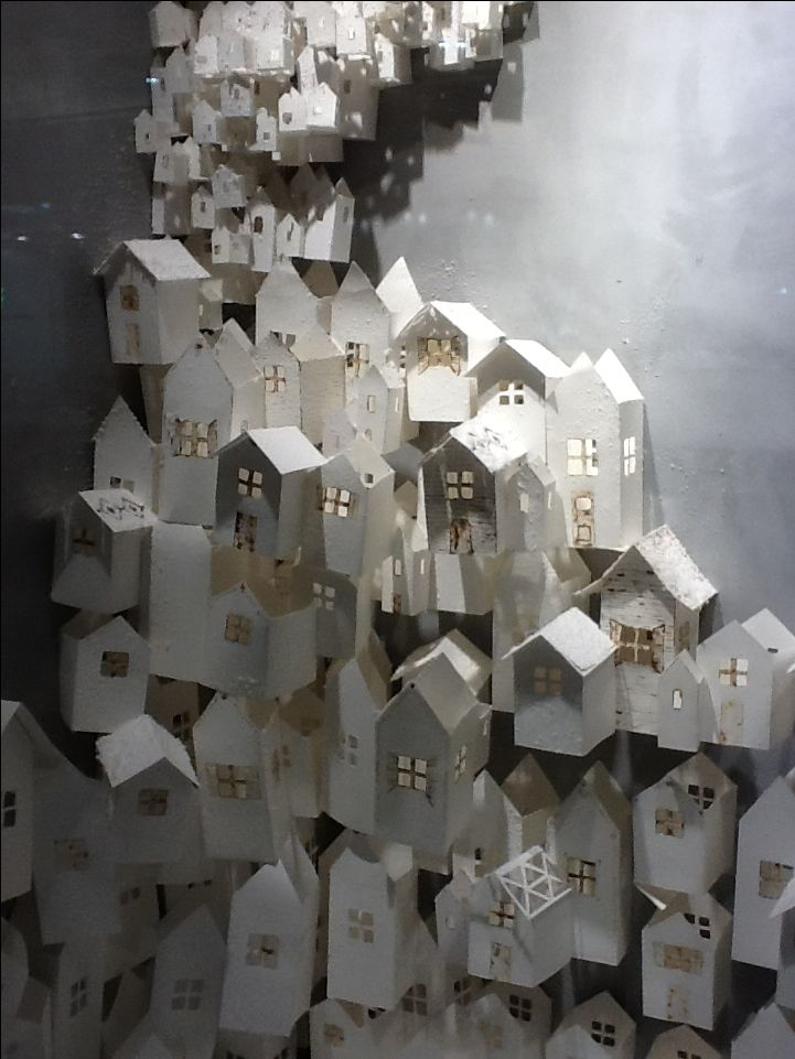 Paper houses - Anthropologie window display 2012  this would be cool for halloween with black paper houses