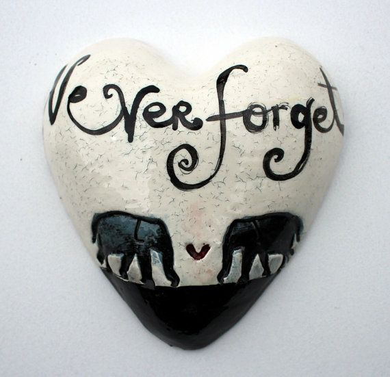 Never forget ceramic heart with 2 elephants. Each heart is handmade so no two are alike. Measurements: 160x160mm and about 60mm in depth. It