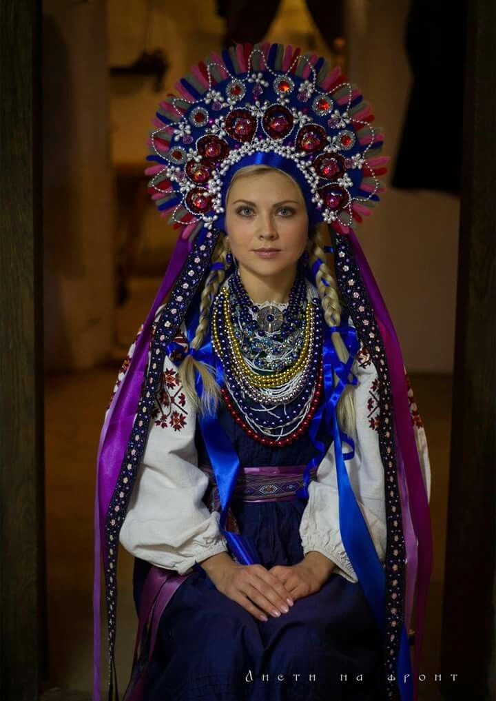 Beautiful take on a traditional Ukrainian women's costume in blue and purple.