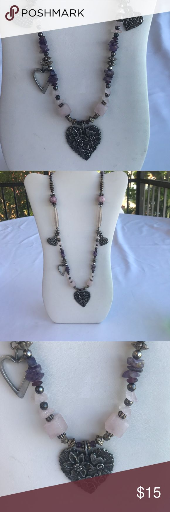 ❤️❤️ Long heart beaded necklace Very cute necklace the large heart is signed  I think it's says MARDE.  I was unable to find out any information on the signature. The chain is made with Silvertone beads and hearts in between those beads are  round amethyst rough-cut  amethyst, pink quartz and small little beads which may also be an amethyst.  Bundle of three or more items to receive 15% off. I ship same day or next. Jewelry Necklaces