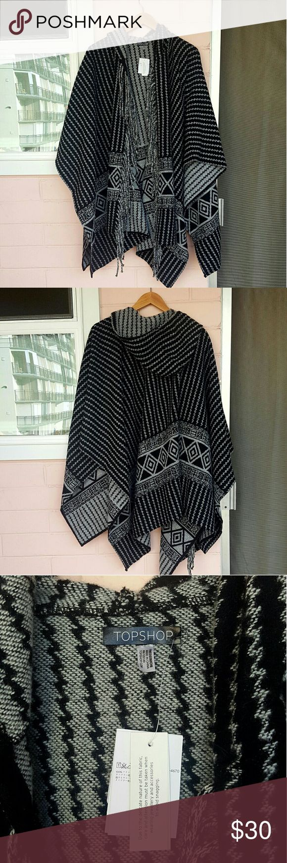 TOPSHOP HOODED PONCHO *black and gray hooded poncho *one size *brand new with tags *perfect to wear or use as a blanket for chilly nights *comes from a smoke-FREE & pet-FREE home Topshop Jackets & Coats