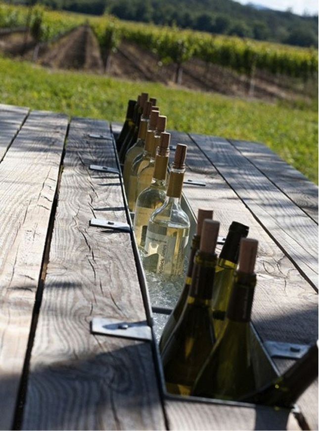 Cut an inlay into an old picnic table and put metal bins in. Cooler in a table! #DIY
