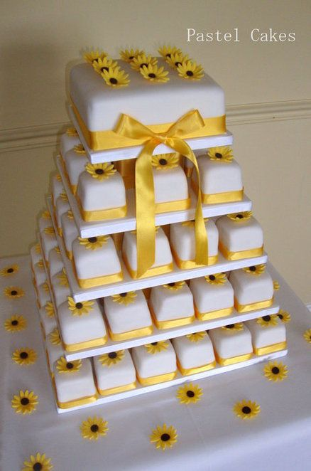 Sunflower miniature wedding cake tower. Indian Weddings Inspirations. Yellow Wedding Cake. Repinned by #indianweddingsmag indianweddingsmag.com #weddingcake
