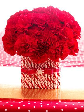 Peppermint Vase,Wrap a vase in peppermint sticks and pair with red flowers for a pretty Christmas decoration.: Centerpiece Ideas, Craft, Christmas Centerpieces, Christmas Decorations, Candy Canes, Holidays, Christmas Table, Christmas Ideas