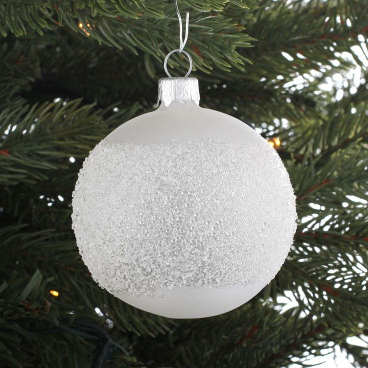 Very luxurious and decorative glass Christmas bauble, milk white with glitter details.