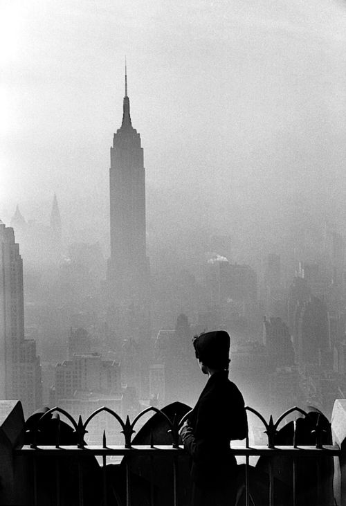 Iconic Photo of Lady Viewing the Empire State Building from the Top