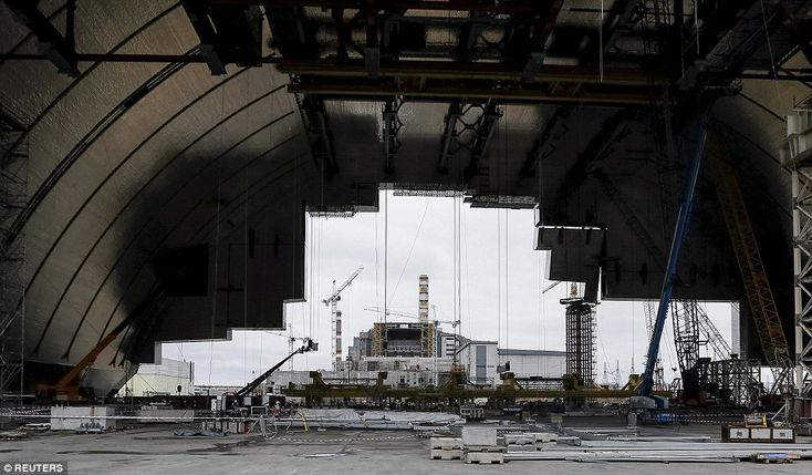 A general view shows the construction of the New Safe Confinement (NSC) structure at the s...