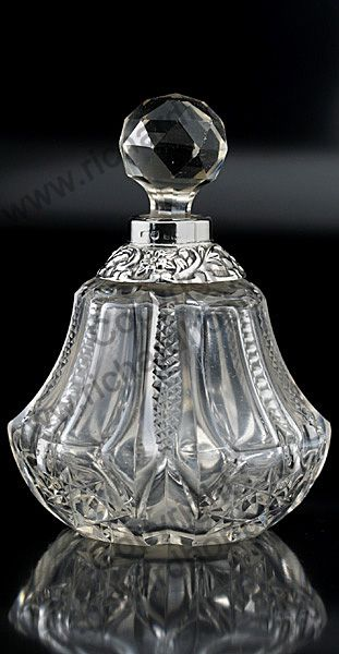 ANTIQUE GLASS: DRESSING TABLE BOTTLE, SETS, BOXES, POTS, & RELATED. 1904 CUT CRYSTAL DRESSING TABLE SCENT PERFUME BOTTLE WITH EMBOSSED SILVER COLLAR