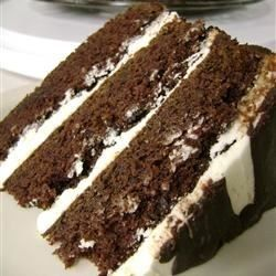 The robust taste of Irish stout beer enhances the chocolate flavor of this layer cake. An Irish cream liqueur-flavored frosting and drizzle of bittersweet chocolate over all complete this perfect St. Patrick's Day dessert.