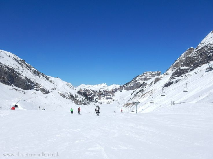 Skiing in Avoriaz, village in the distance.  Avoriaz and Chatel are both snow sure resorts of the Portes du Soleil