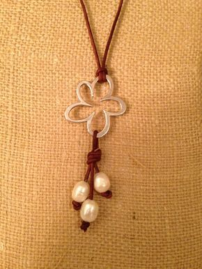 Flower freshwater pearls and leather necklace by sandandseapearls, Looks like a cherry blossom to me ;)