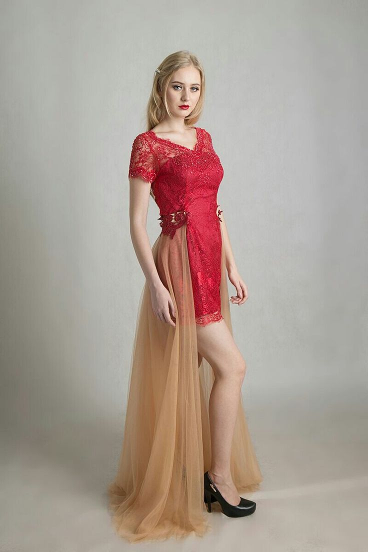 Red brocade dress by Ivone Sulistia