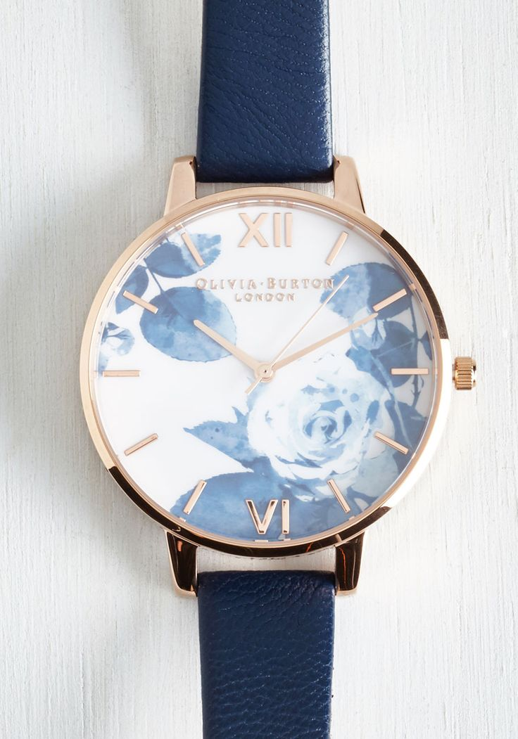 Trick of the Clock Watch. Come rain or shine, it always feels like spring when you glance at this gold and navy watch by Olivia Burton! #blue #modcloth