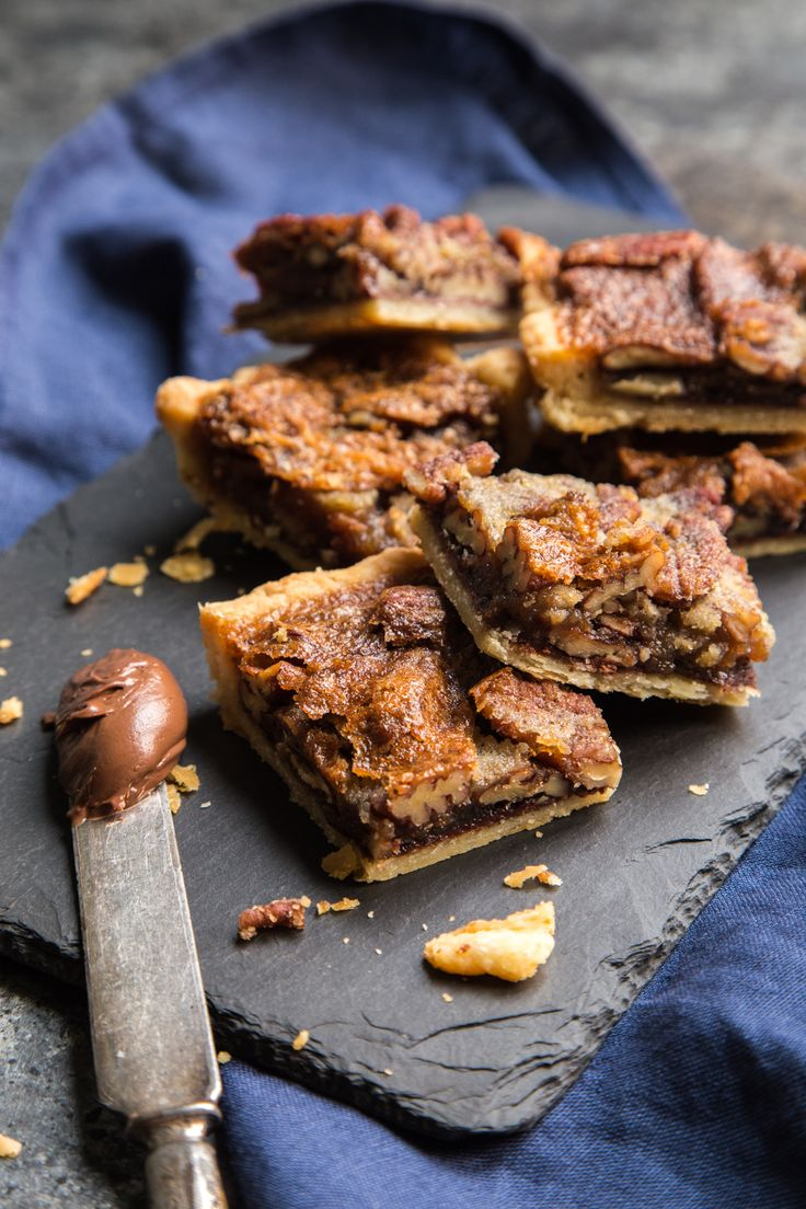 A much easier to transport version of your favorite holiday pie, all   with a little added chocolate in the bottom! These Nutella Pecan Pie   Bars are going to be your go to holiday treat!
