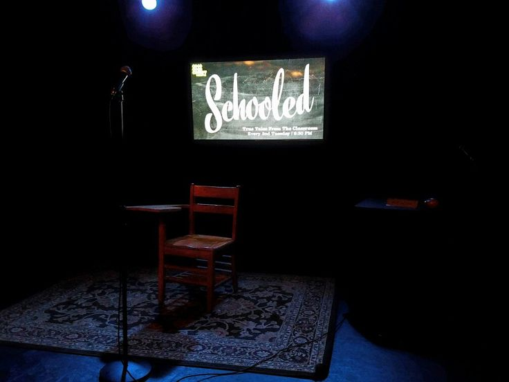 The stage is set for the monthly performance of Schooled, a school-themed storytelling showcase at Good Good Comedy Theater in the Chinatown neighborhood of downtown Philadelphia.