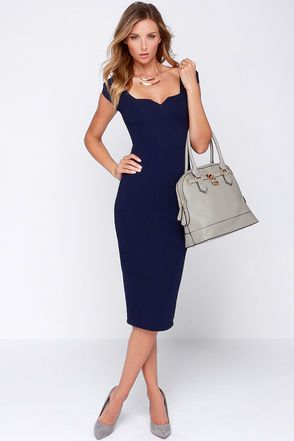 "A squared-off scoop neckline boasts chic notched accents, giving an extra dash of allure to this navy blue dress. Puffed cap sleeves complement the darted bodice, and its solid athletic mesh knit brings a new textured approach down to a midi-length skirt with kick pleat at back. Hidden back zipper/clasp closure. Fully lined. Model is 5'9"" and wearing a size X-Small. Self: 95% Polyester, 5% Spandex. Lining: 100% Polyester. Hand Wash Cold. Made With Love in the U.S.A."