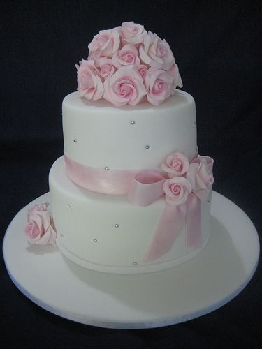 White Wedding Cake  Pink Roses, via Flickr.