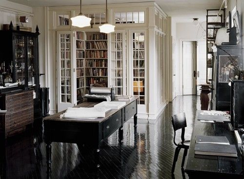 Gorgeous interior multi-paned doors integrate the library into the rest of the room yet keep it special and private