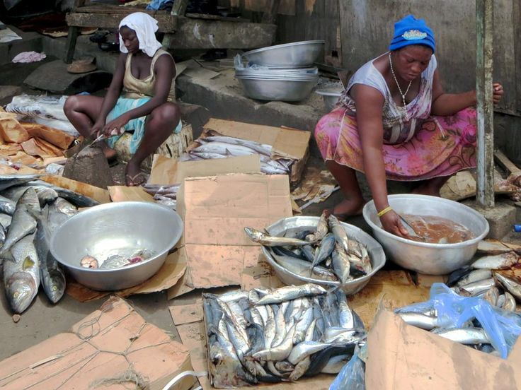 Ga women cleaning fish for smoking at Jamestown in Accra, Ghana.