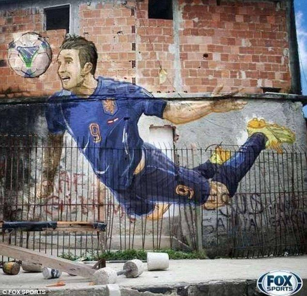 Superb: This piece of Brazilian street art might be as unforgettable as Robin van Persie's header itself