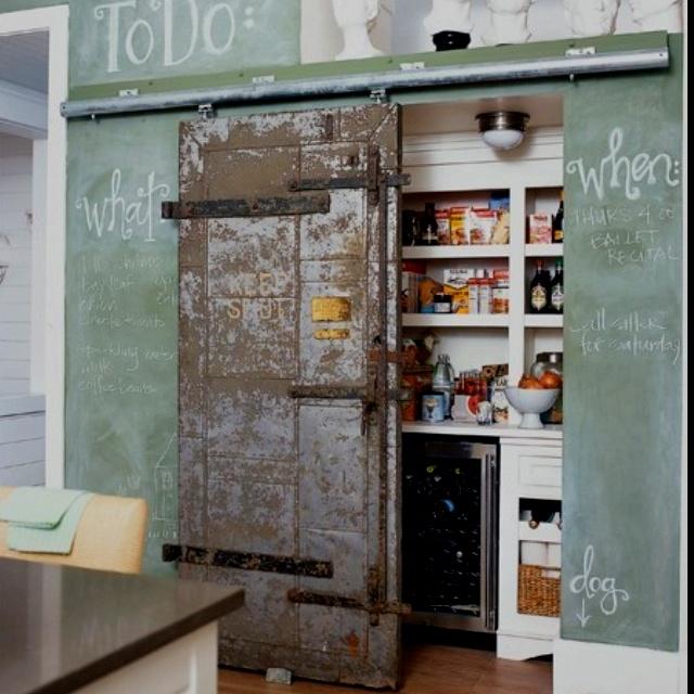 chalkboard wall + barn door + hidden storage