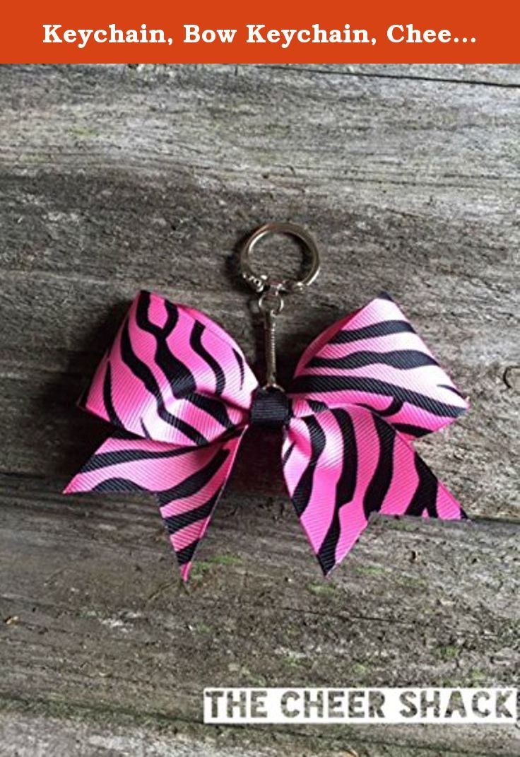 """Keychain, Bow Keychain, Cheer Bow Keychain. Zebra Cheer bow keychain. 1.5"""" grosgrain ribbon. Embellished with The Cheer Shack's signature rhinestone. Great for decorating backpacks, bags, etc. Print design and color on each bow may vary."""