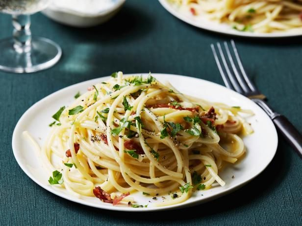 Get Spaghetti alla Carbonara Recipe from Food Network-use 4 eggs instead and don't drain bacon fat