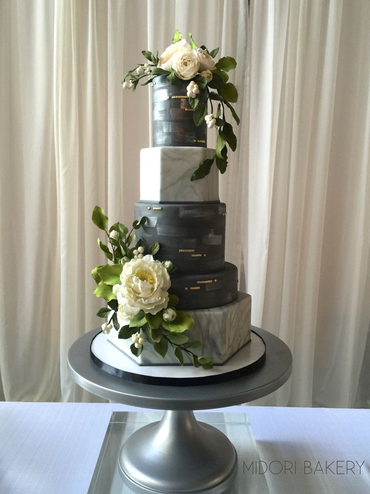 5-tier Wedding Cake with two marbled hexagon tiers and three round slate grey tiers with silver brushstrokes and gold accents with hand-sculpted sugar flowers and snow berries by Midori Bakery.