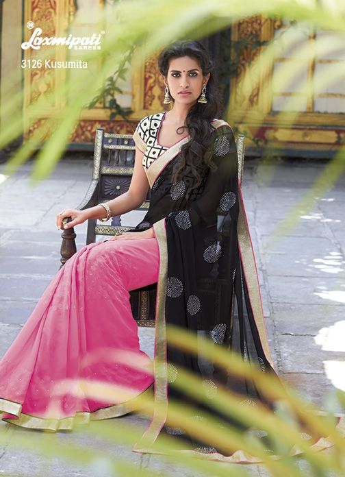 Dazzling diamond work on this half-half georgette saree is glamorize with its terrific printed blouse piece.