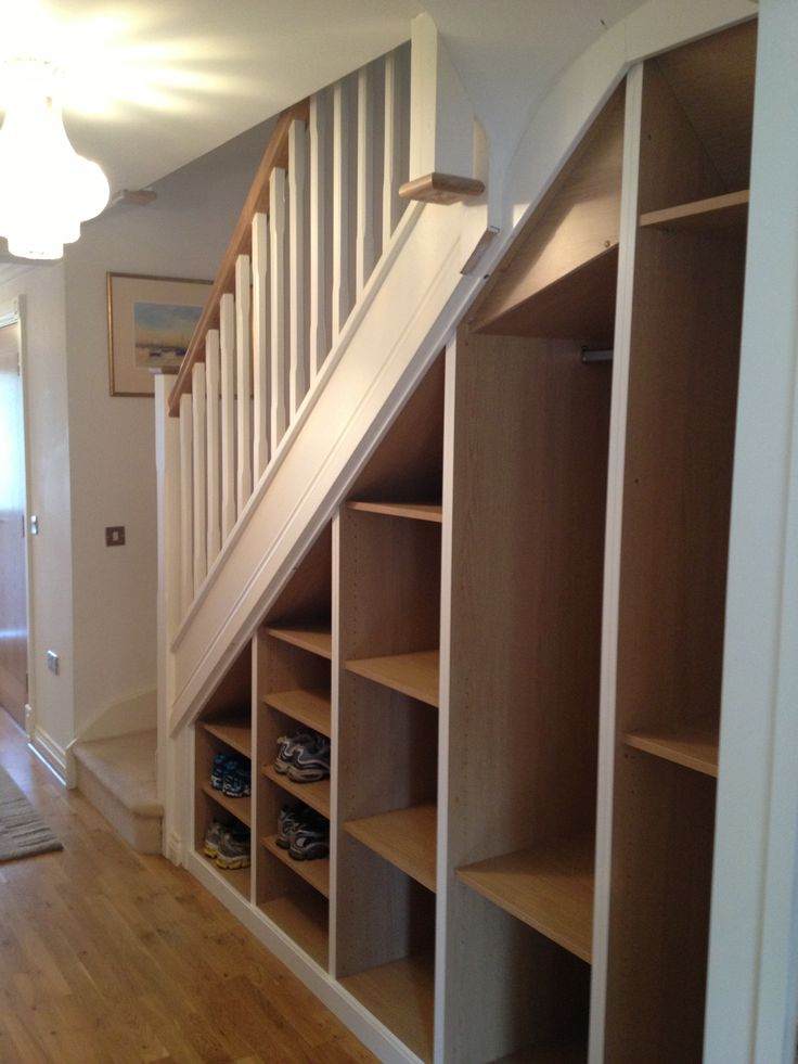 Bespoke Under-stairs storage without doors by Anthony Mullan furniture
