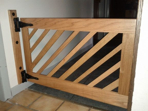 "DIY Dog Gate: we need something that fits 64"". I could do something similar to this, but have two gates that close in the middle instead of just one giant gate. DIY project for later."