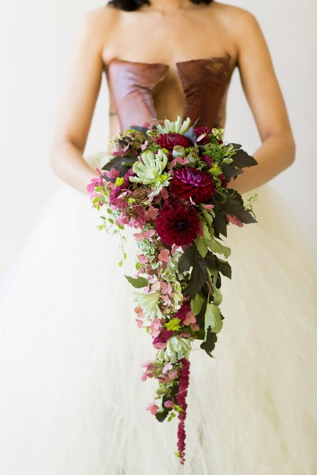 Love love love this deep colored cascading flower wedding bouquet.