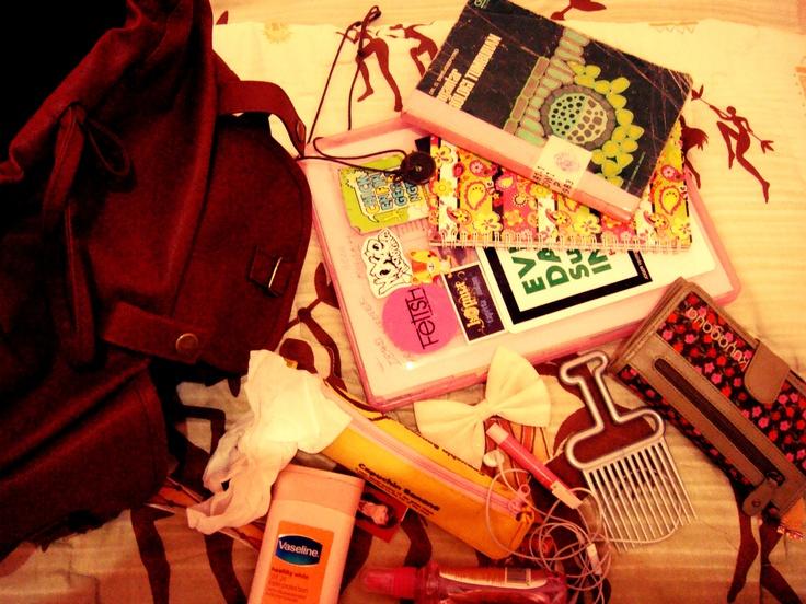 these things always take me to campus. wallet, comb, vasline handbody, pencase, lipbalm, headsheet, and binder