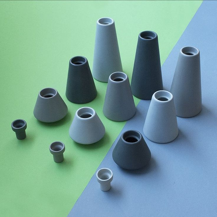 Playful volcanoes in all available shapes, sizes and colors. Design by Anca Fetcu.