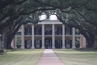 I don't want an overly formal house, but there's something I love about southern mansions. (And I would *adore* a tree-lined avenue...)