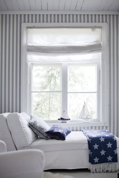All white with a splash of blue makes for a tranquil bedroom