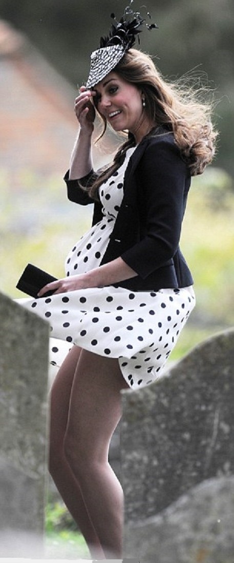 Tthe Duchess of Cambridge might have expected all eyes to be on her sizeable bump.  But windy weather and her flimsy outfit had other ideas.  Kate was left red-faced after the gusts lifted up her 38 euro polka-dot dress, drawing attention instead to her thighs.  Seemingly unaware that her skirt had blown up, revealing her shapely legs, she gripped her black and white fascinator rather than her hem, laughing as she did so.