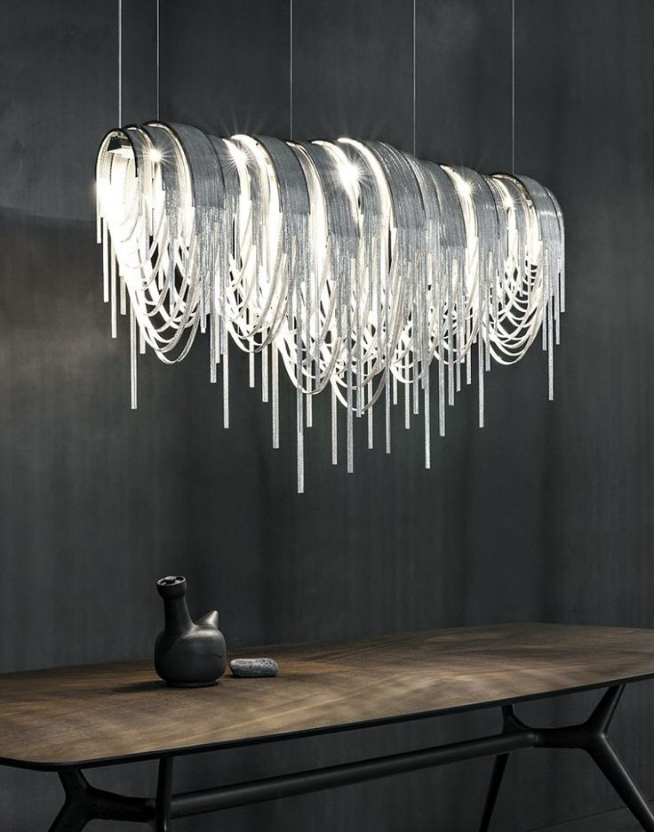 This dazzling chandelier has been made from thin nickel chains with LED lighting.