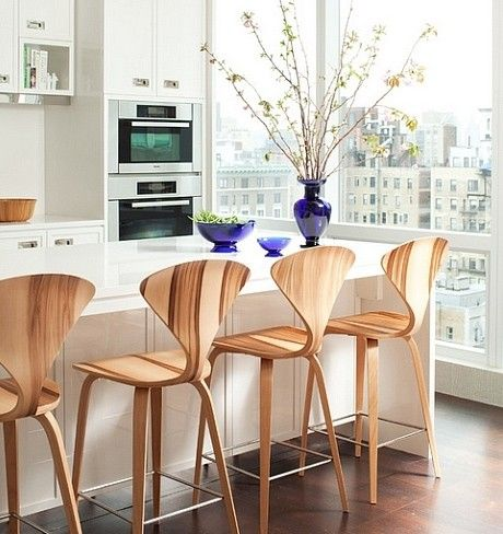 The Cherner Stool is made of molded plywood and slips underneath the kitchen counter at 25 inches tall.
