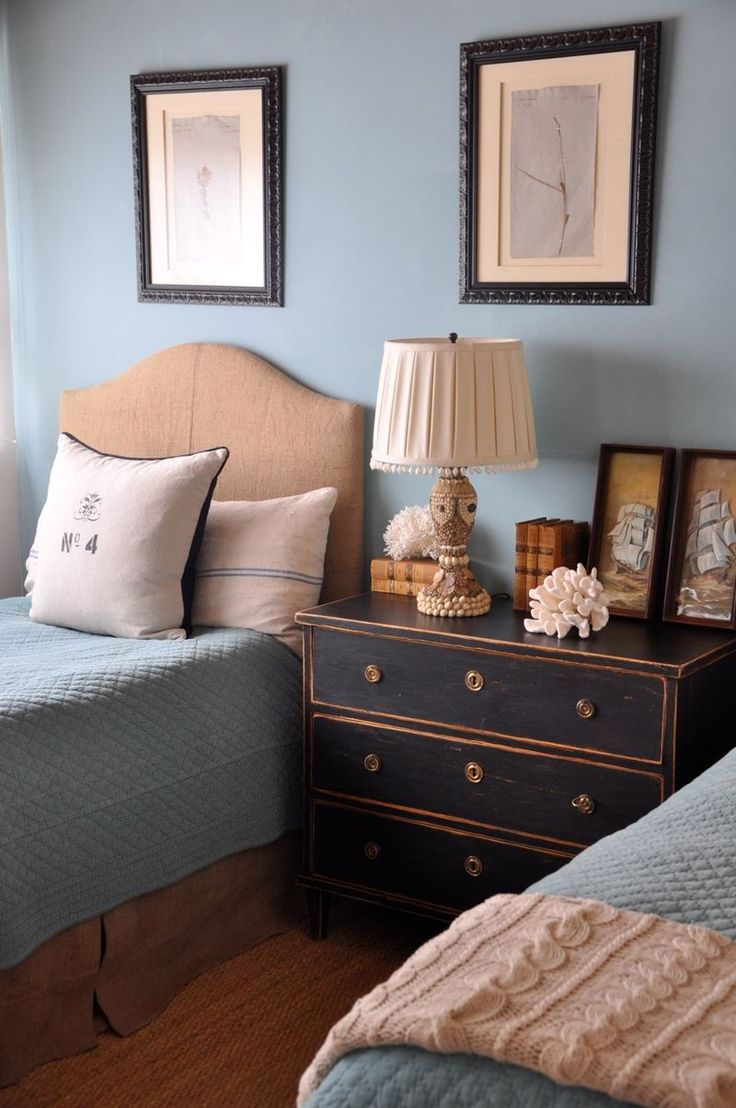 I love a shared nightstand between two twin beds. Great colors too!